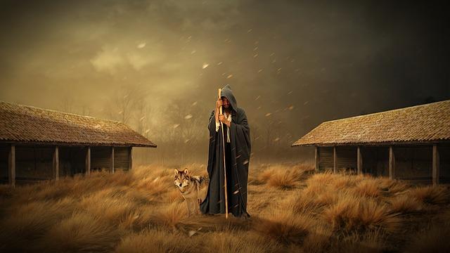 Hombre con capucha con un lobo